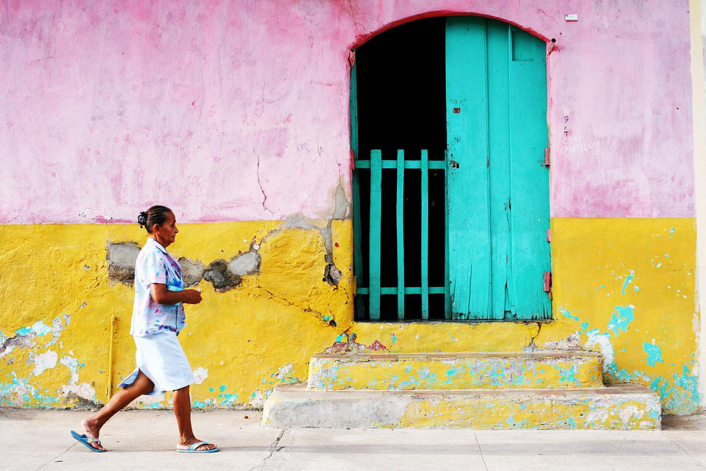 A woman walks by a street in Masaya.